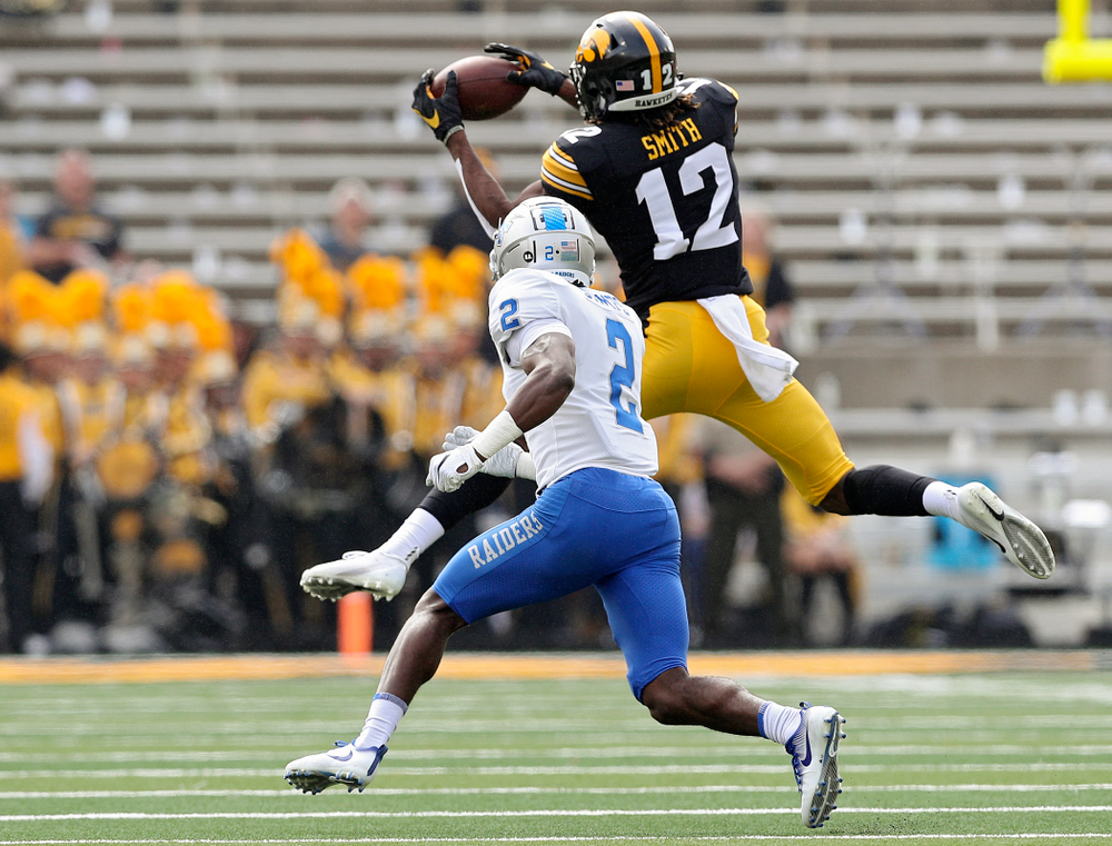 Iowa Hawkeyes wide receiver Brandon Smith (12) pulls in a pass during the second quarter of their game at Kinnick Stadium in Iowa City on Saturday, Sep 28, 2019. (Stephen Mally/hawkeyesports.com)
