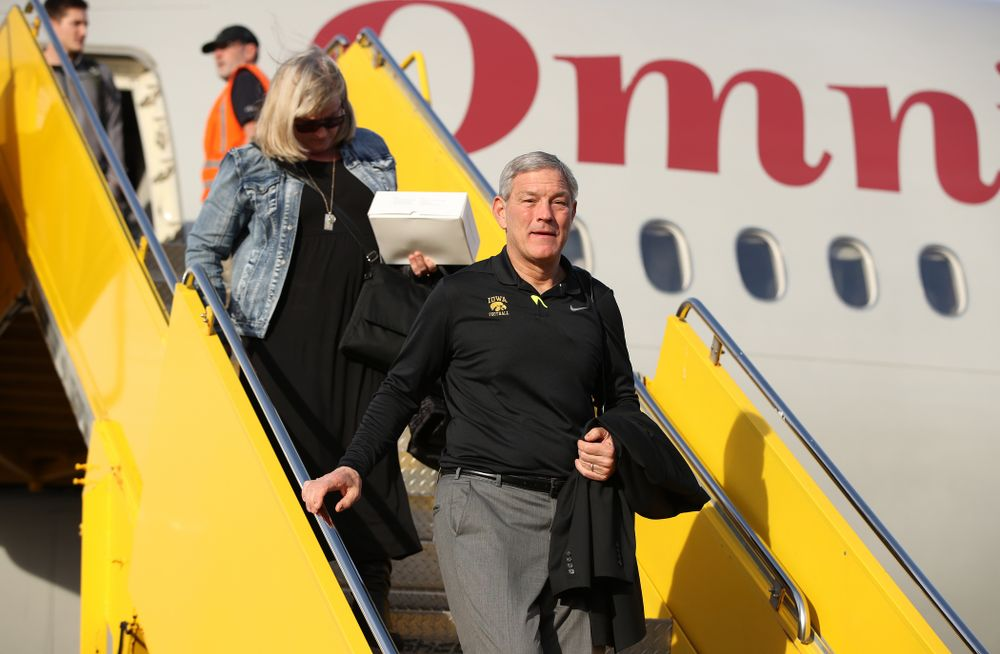 Iowa Hawkeyes head coach Kirk Ferentz disembarks the team plane Wednesday, December 26, 2018 as they arrive in Tampa, Florida for the Outback Bowl. (Brian Ray/hawkeyesports.com)
