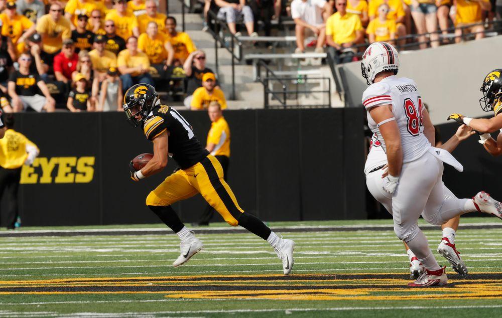 Iowa Hawkeyes wide receiver Kyle Groeneweg (14) returns a punt against the Northern Illinois Huskies Saturday, September 1, 2018 at Kinnick Stadium. (Brian Ray/hawkeyesports.com)