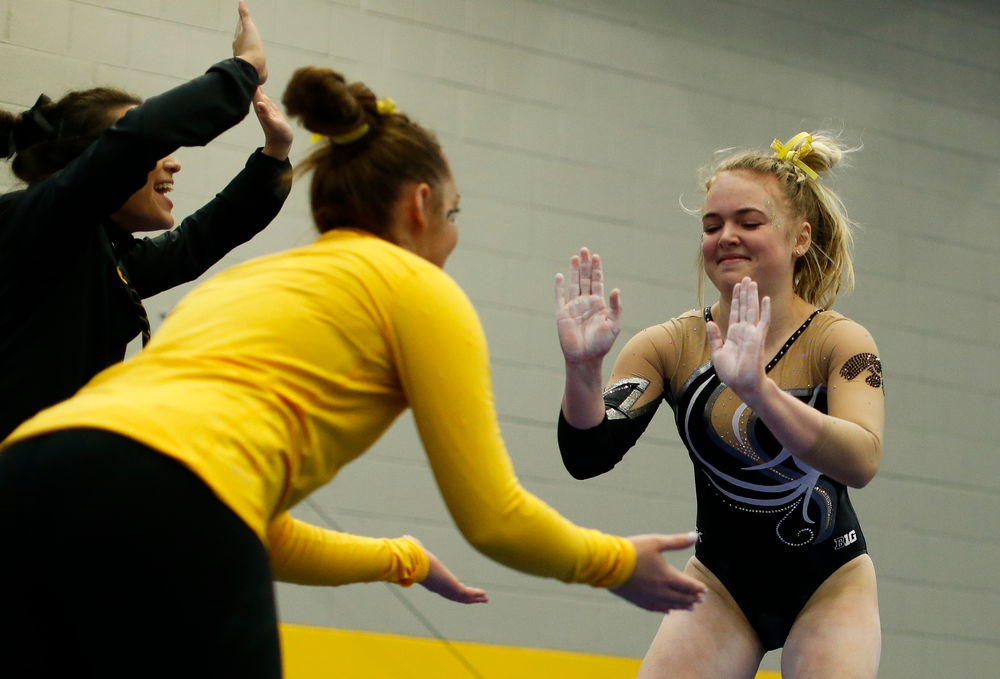 Charlotte Sullivan celebrates after competing on the vault during the Black and Gold Intrasquad meet at the Field House on 12/2/17. (Tork Mason/hawkeyesports.com)