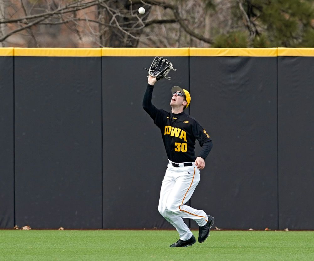 Iowa Hawkeyes left fielder Connor McCaffery (30) pulls in a fly ball for an out during the fifth inning of their game against Illinois at Duane Banks Field in Iowa City on Saturday, Mar. 30, 2019. (Stephen Mally/hawkeyesports.com)