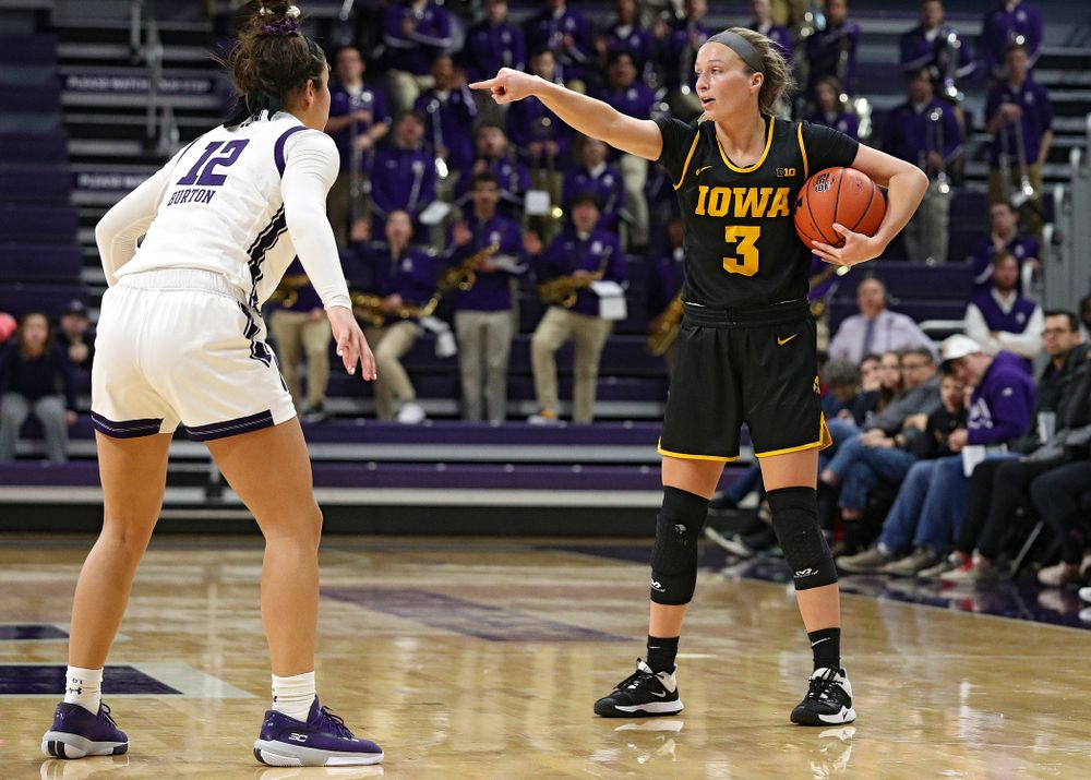 Iowa Hawkeyes guard Makenzie Meyer (3) directs traffic during the second quarter of their game at Welsh-Ryan Arena in Evanston, Ill. on Sunday, January 5, 2020. (Stephen Mally/hawkeyesports.com)