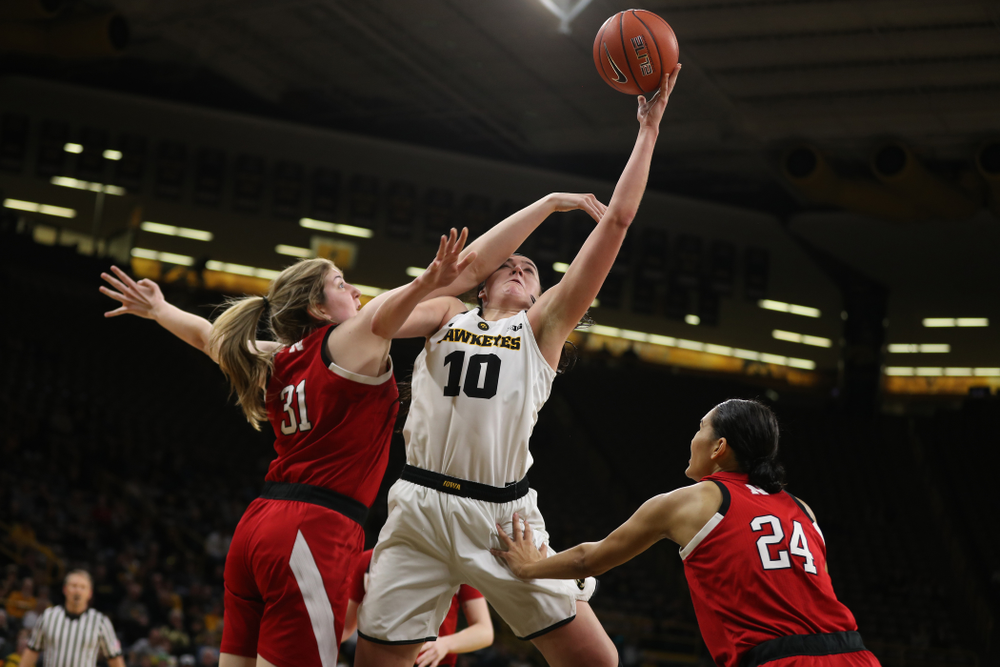 Iowa Hawkeyes forward Megan Gustafson (10) makes a basket and draws a foul against the Nebraska Cornhuskers Thursday, January 3, 2019 at Carver-Hawkeye Arena. (Brian Ray/hawkeyesports.com)