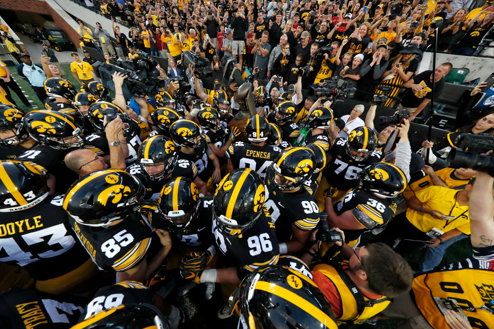 The Iowa Hawkeyes celebrate with the Cy-Hawk trophy following their game against the Iowa State Cyclones Saturday, September 8, 2018 at Kinnick Stadium. (Brian Ray/hawkeyesports.com)
