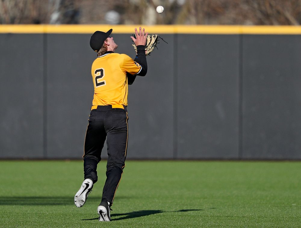 Iowa Hawkeyes shortstop Brendan Sher (2) pulls in a pop up for an out during the sixth inning of their game at Duane Banks Field in Iowa City on Tuesday, Apr. 2, 2019. (Stephen Mally/hawkeyesports.com)