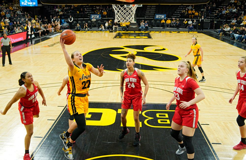 Iowa Hawkeyes guard Kathleen Doyle (22) scores a basket inside of all five Ohio State Buckeyes players during the second quarter of their game at Carver-Hawkeye Arena in Iowa City on Thursday, January 23, 2020. (Stephen Mally/hawkeyesports.com)