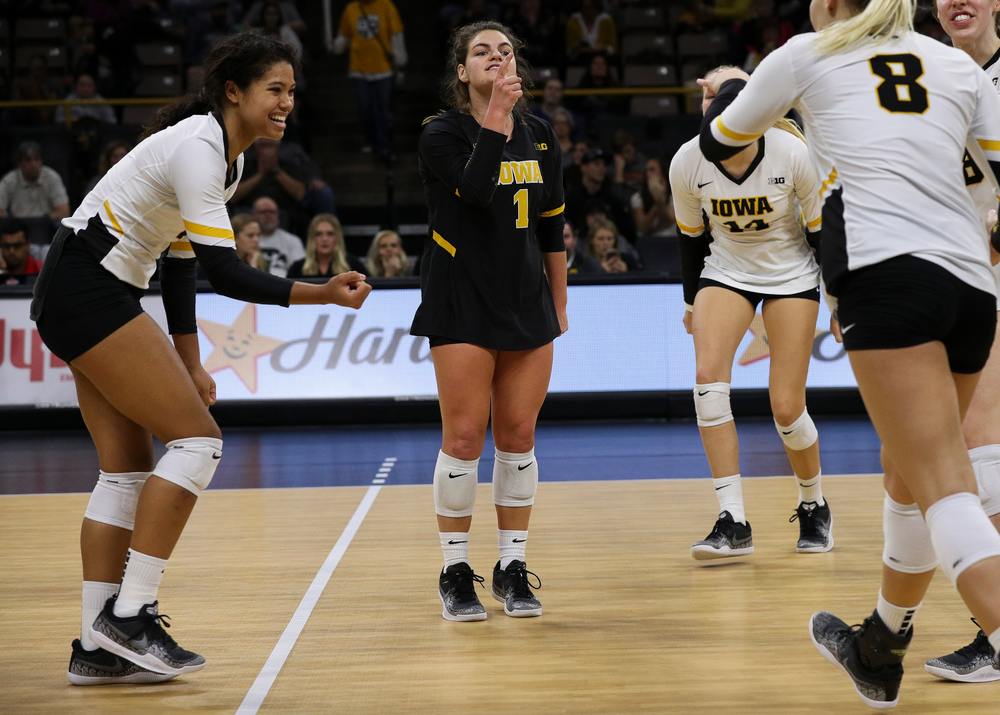 Iowa Hawkeyes setter Brie Orr (7) and Iowa Hawkeyes defensive specialist Molly Kelly (1) celebrate after winning a point during a match against Rutgers at Carver-Hawkeye Arena on November 2, 2018. (Tork Mason/hawkeyesports.com)