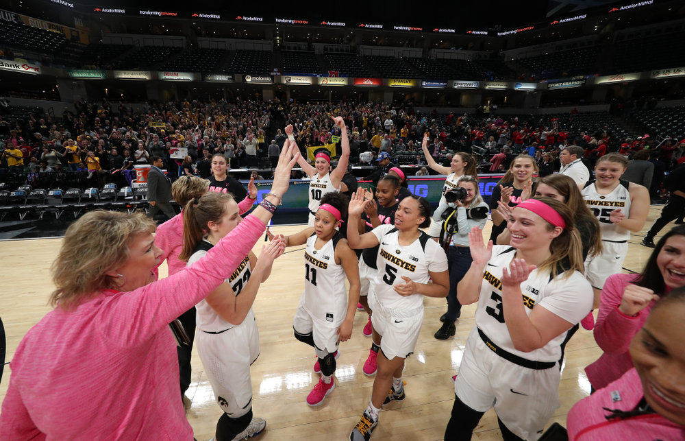 The Iowa Hawkeyes celebrate their win against the Rutgers Scarlet Knights in the semi-finals of the Big Ten Tournament Saturday, March 9, 2019 at Bankers Life Fieldhouse in Indianapolis, Ind. (Brian Ray/hawkeyesports.com)