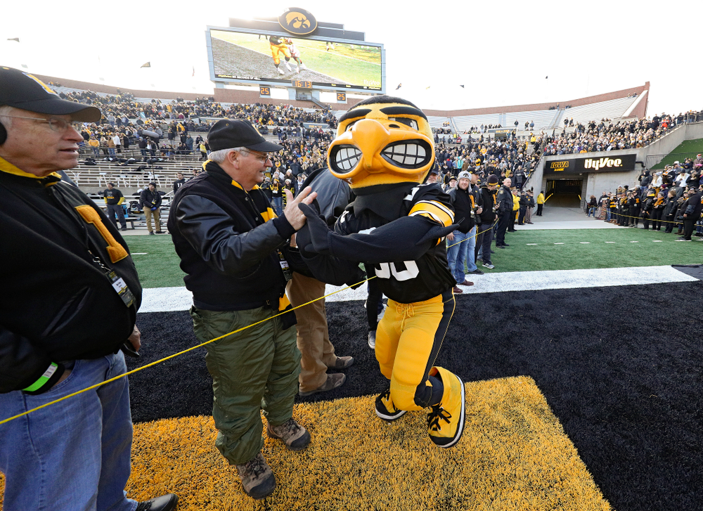 Herky gives high-fives to University of Iowa letterwinners before their game at Kinnick Stadium in Iowa City on Saturday, Nov 23, 2019. (Stephen Mally/hawkeyesports.com)