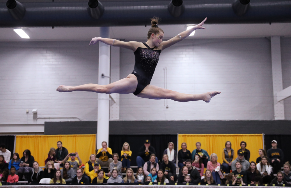 Mackenzie Vance competes on the beam during the Black and Gold intrasquad meet Saturday, December 1, 2018 at the University of Iowa Field House. (Brian Ray/hawkeyesports.com)