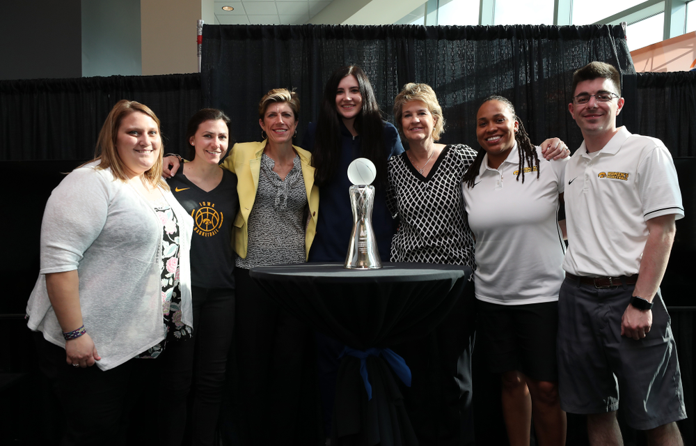 Iowa Hawkeyes forward Megan Gustafson (10) poses for  photo with the Iowa Women's Basketball staff after winning the Associated Press Player Of The Year during a news conference Thursday, April 4, 2019 at Amalie Arena in Tampa, FL. (Brian Ray/hawkeyesports.com)