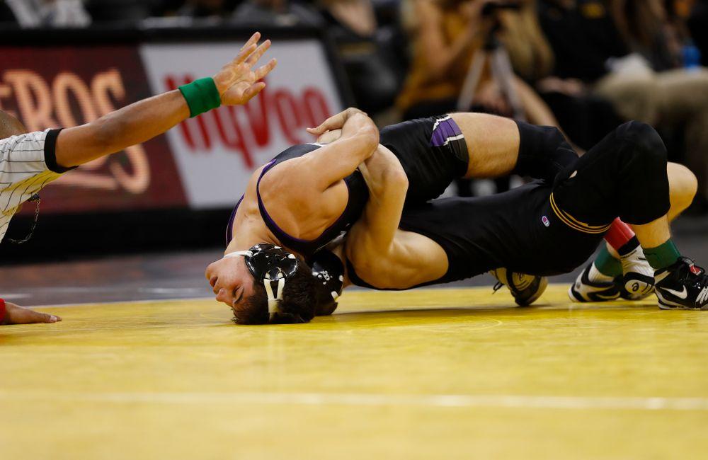 Iowa's Spencer Lee wrestles Northwestern's Sebastian Rivera at 125 pounds