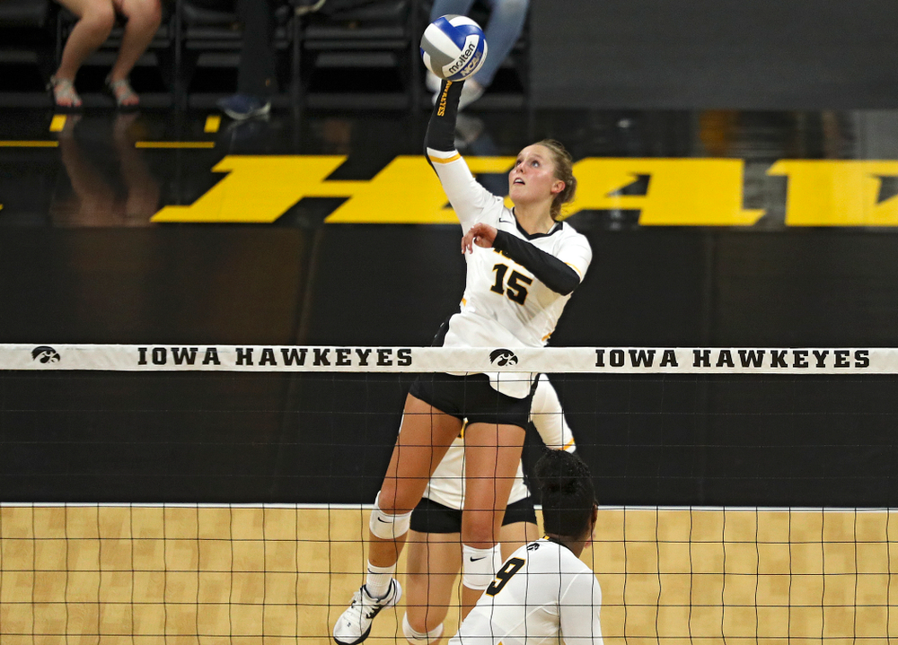 Iowa's Maddie Slagle (15) puts up a shot during their Big Ten/Pac-12 Challenge match at Carver-Hawkeye Arena in Iowa City on Saturday, Sep 7, 2019. (Stephen Mally/hawkeyesports.com)