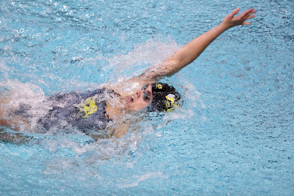 IowaÕs Kennedy Gilbertson competes in the 100 yard backstroke against Notre Dame and Illinois Saturday, January 11, 2020 at the Campus Recreation and Wellness Center.  (Brian Ray/hawkeyesports.com)