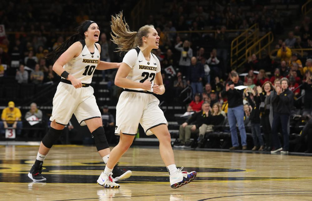Iowa Hawkeyes guard Kathleen Doyle (22) and forward Megan Gustafson (10)  react to an and one by forward Hannah Stewart (21) against the Purdue Boilermakers Sunday, January 27, 2019 at Carver-Hawkeye Arena. (Brian Ray/hawkeyesports.com)