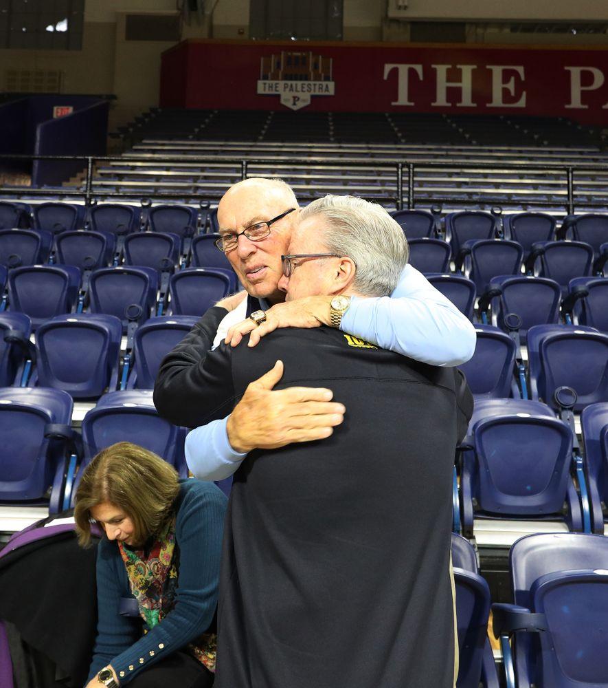 Iowa Hawkeyes head coach Fran McCaffery talks with Bob Weinhauer, his head coach from Penn, before practice at the Palestra Friday, January 3, 2020 in Philadelphia. (Brian Ray/hawkeyesports.com)