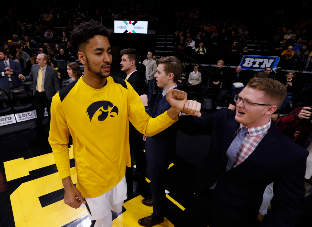 Iowa Hawkeyes forward Dom Uhl (25) and manager Lucas Pauley