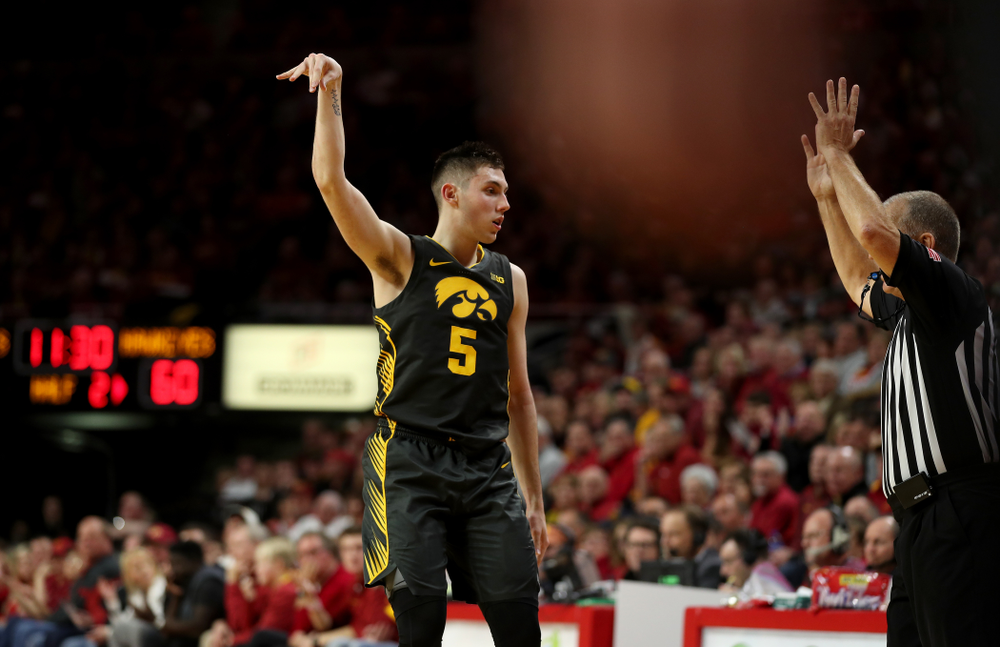 Iowa Hawkeyes guard CJ Fredrick (5) knocks down a three point basket against the Iowa State Cyclones Thursday, December 12, 2019 at Hilton Coliseum in Ames, Iowa(Brian Ray/hawkeyesports.com)