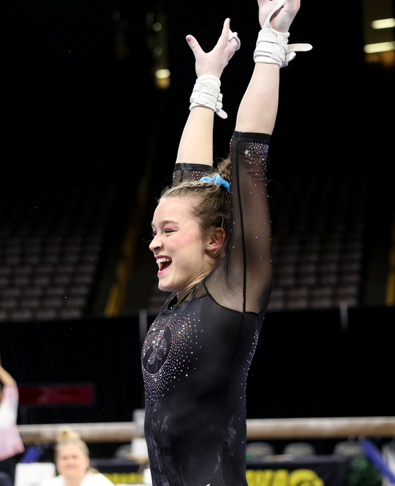 Iowa's Mackenzie Vance competes on the bars against Michigan Friday, February 14, 2020 at Carver-Hawkeye Arena. (Brian Ray/hawkeyesports.com)