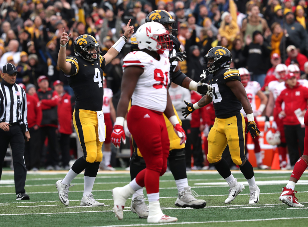 Iowa Hawkeyes quarterback Nate Stanley (4) celebrates a touchdown pass to wide receiver Brandon Smith (12)  against the Nebraska Cornhuskers Friday, November 23, 2018 at Kinnick Stadium. (Brian Ray/hawkeyesports.com)
