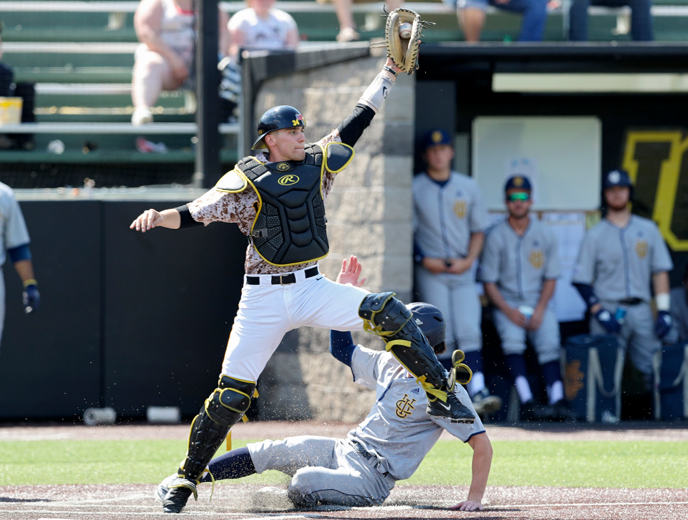Iowa Hawkeyes catcher Austin Martin (34) pulls in a throw for a force out at home plate during the fifth inning of their game against UC Irvine at Duane Banks Field in Iowa City on Sunday, May. 5, 2019. (Stephen Mally/hawkeyesports.com)