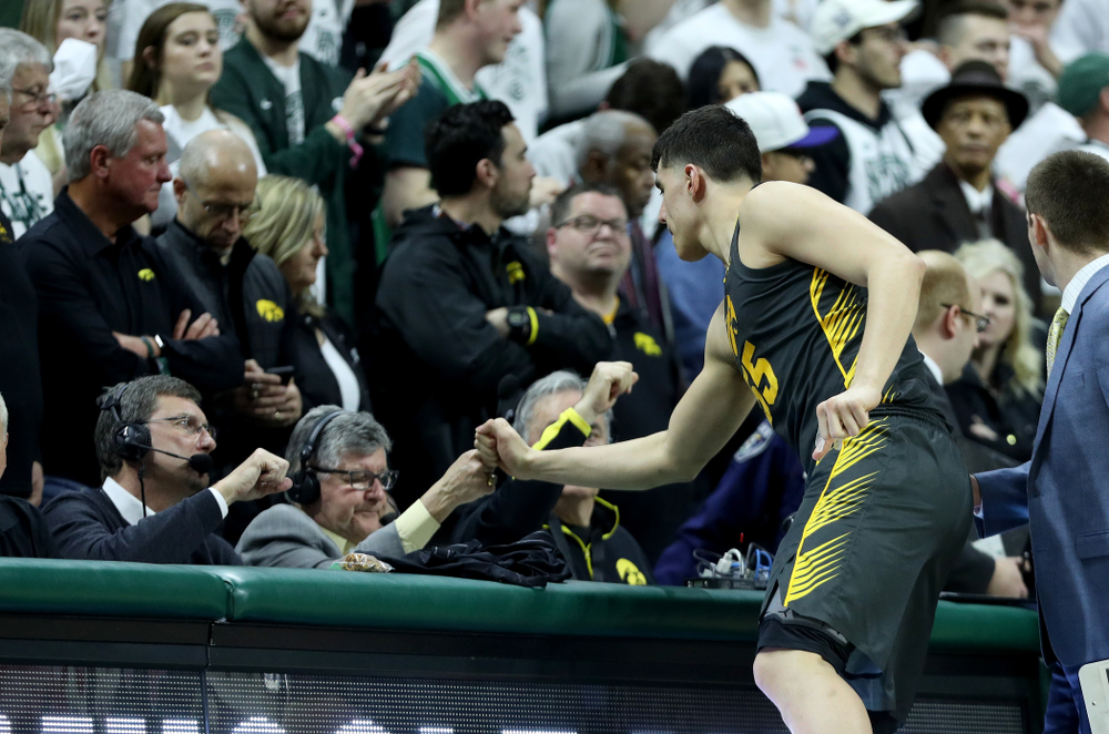 Iowa Hawkeyes forward Luka Garza (55) fist bumps Gary Dolphin against Michigan State Tuesday, February 25, 2020 at the Breslin Center in East Lansing, MI. (Brian Ray/hawkeyesports.com)