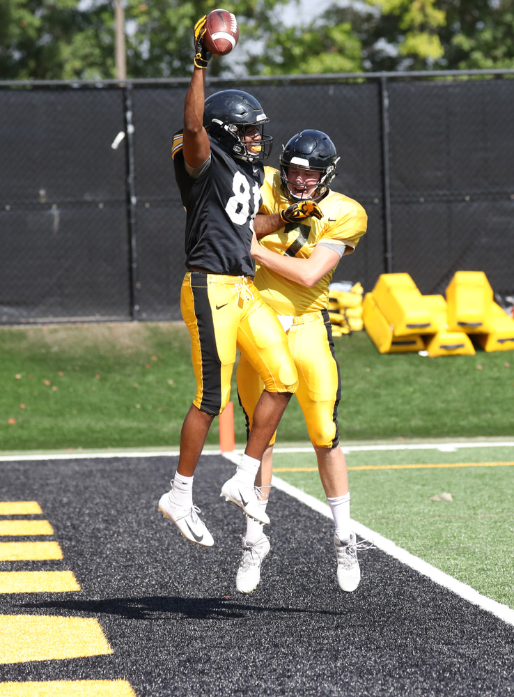 WR Desmond Hutson celebrates with QB Spencer Petras