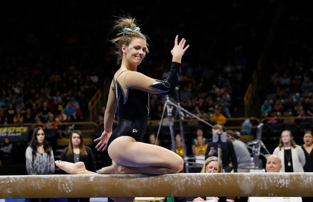 Iowa's Sydney Hogan competes on the beam against the Nebraska Cornhuskers