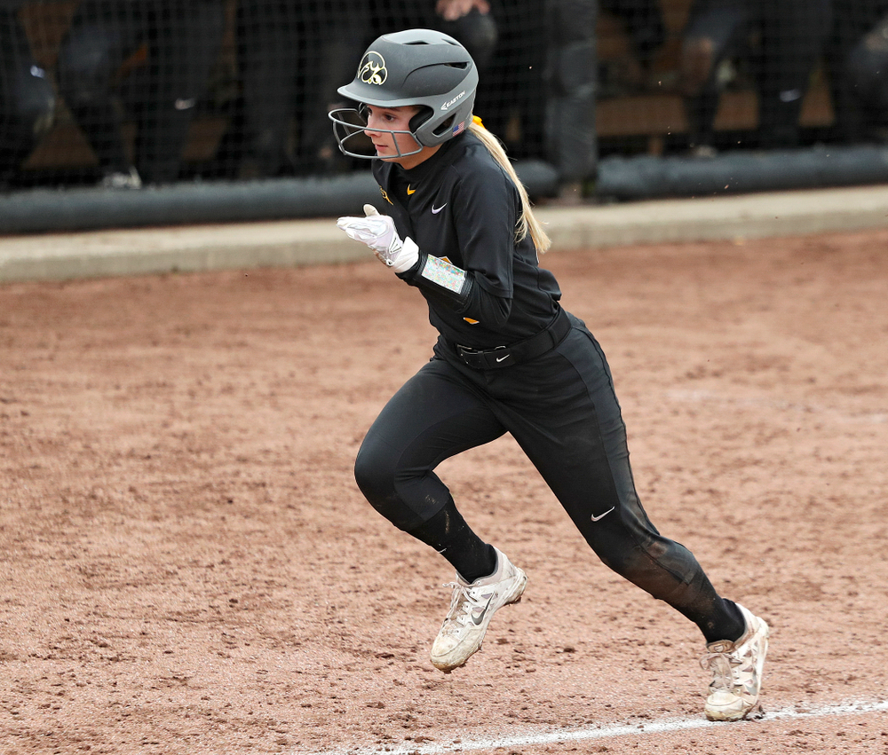 Iowa infielder Taylor Ryan (28) runs home to score a run during the sixth inning of their game against Iowa Softball vs Indian Hills Community College at Pearl Field in Iowa City on Sunday, Oct 6, 2019. (Stephen Mally/hawkeyesports.com)
