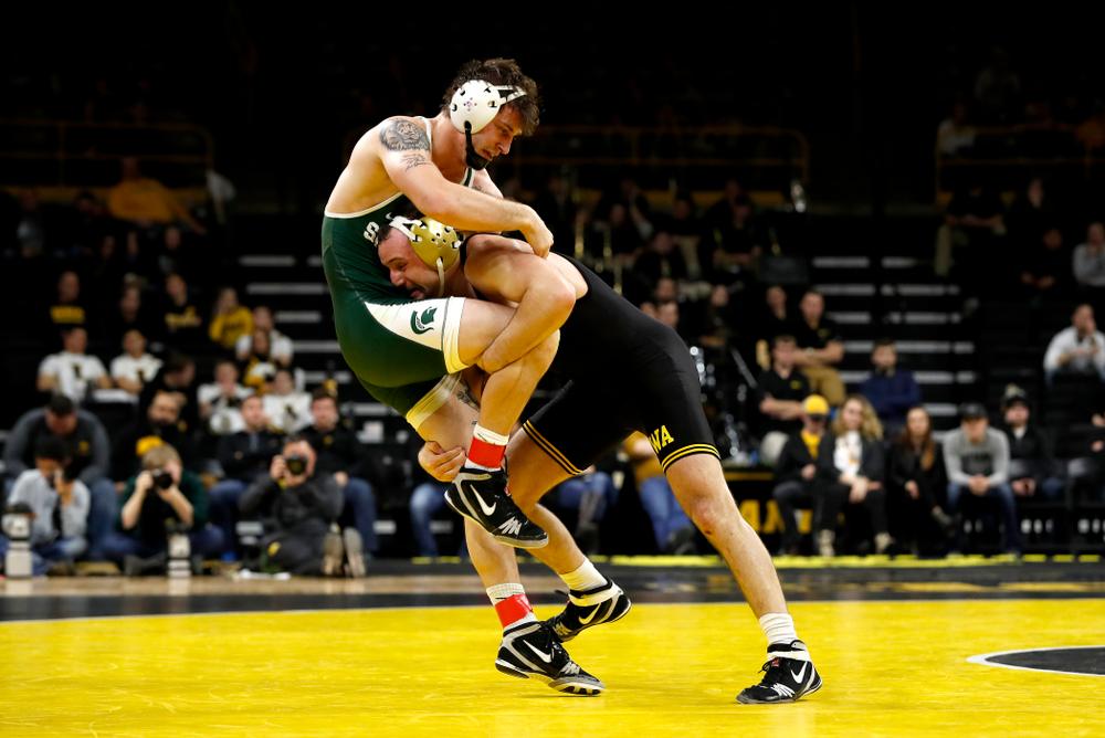 Iowa's Joey Gunther wrestles Michigan State's Logan Ritche at 174 pounds.