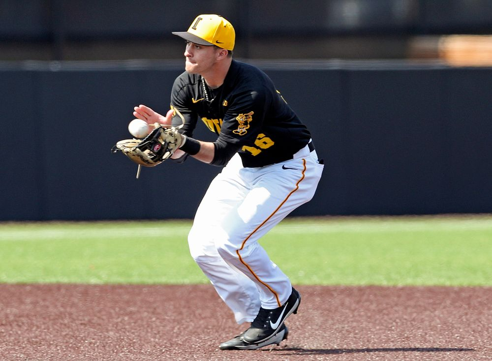 Iowa Hawkeyes shortstop Tanner Wetrich (16) pulls in a ball during the first inning of their game against Rutgers at Duane Banks Field in Iowa City on Saturday, Apr. 6, 2019. (Stephen Mally/hawkeyesports.com)