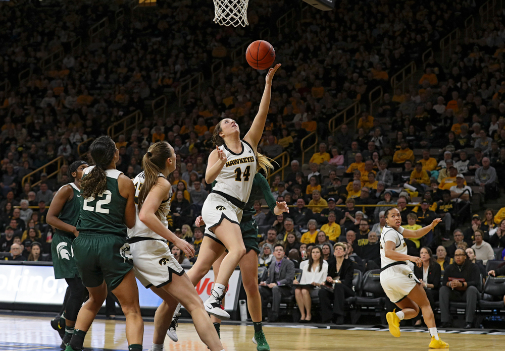 Iowa Hawkeyes guard Gabbie Marshall (24) scores a basket during the third quarter of their game at Carver-Hawkeye Arena in Iowa City on Sunday, January 26, 2020. (Stephen Mally/hawkeyesports.com)