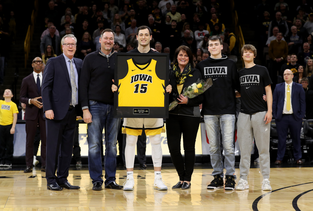 Iowa Hawkeyes forward Ryan Kriener (15) and his family during senior night festivities before their game against the Purdue Boilermakers Tuesday, March 3, 2020 at Carver-Hawkeye Arena. (Brian Ray/hawkeyesports.com)
