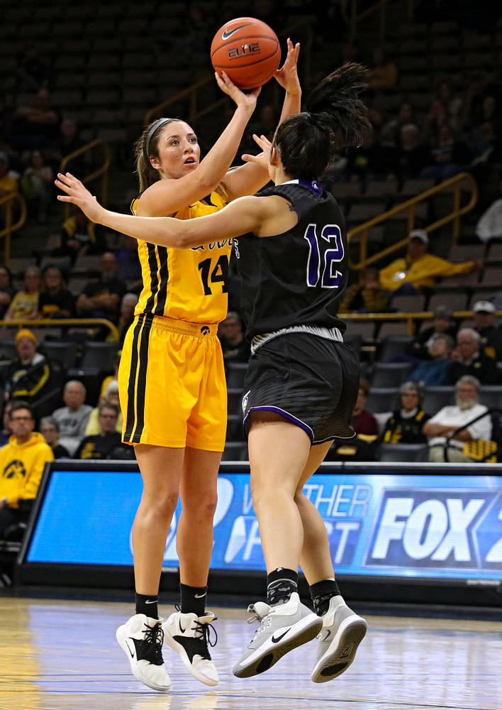 Iowa guard/forward McKenna Warnock (14) makes a basket during the second quarter of their game against Winona State at Carver-Hawkeye Arena in Iowa City on Sunday, Nov 3, 2019. (Stephen Mally/hawkeyesports.com)