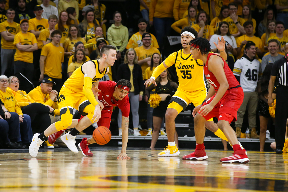 Iowa Hawkeyes guard Connor McCaffery (30) takes control of the ball during the Iowa men's basketball game vs Rutgers on Wednesday, January 22, 2020 at Carver-Hawkeye Arena. (Lily Smith/hawkeyesports.com)