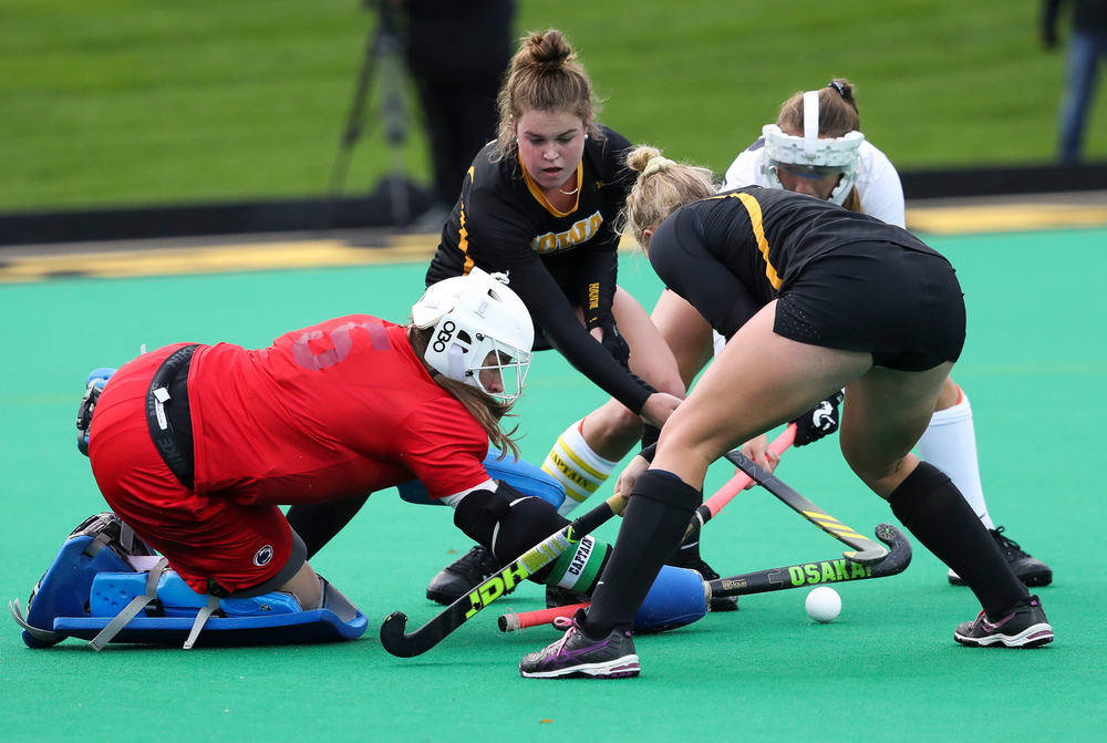 Iowa Hawkeyes midfielder Meghan Conroy (5) and Iowa Hawkeyes midfielder Makenna Grewe (4) scramble for a rebound during a game against No. 6 Penn State at Grant Field on October 12, 2018. (Tork Mason/hawkeyesports.com)