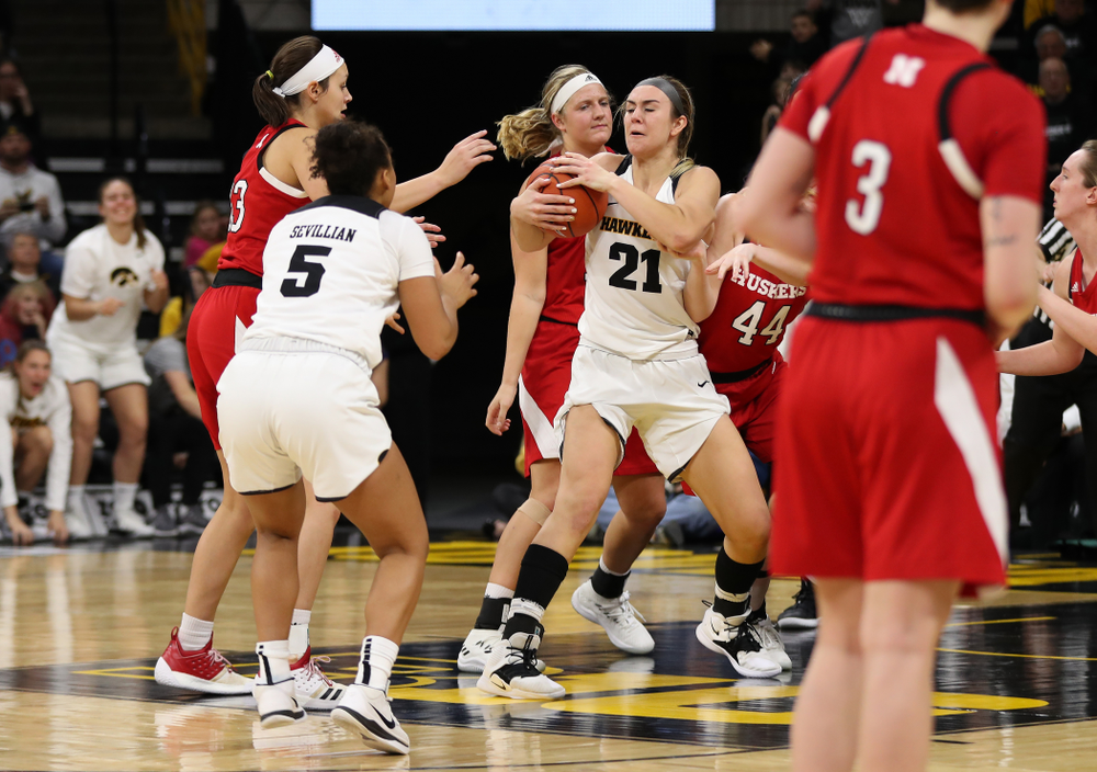 Iowa Hawkeyes forward Hannah Stewart (21) grabs an offensive rebound late against the Nebraska Cornhuskers Thursday, January 3, 2019 at Carver-Hawkeye Arena. (Brian Ray/hawkeyesports.com)