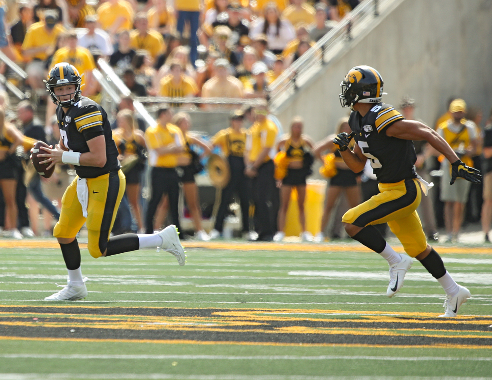 Iowa Hawkeyes quarterback Spencer Petras (7) prepares to pass to wide receiver Oliver Martin (5) during the fourth quarter of their Big Ten Conference football game at Kinnick Stadium in Iowa City on Saturday, Sep 7, 2019. (Stephen Mally/hawkeyesports.com)