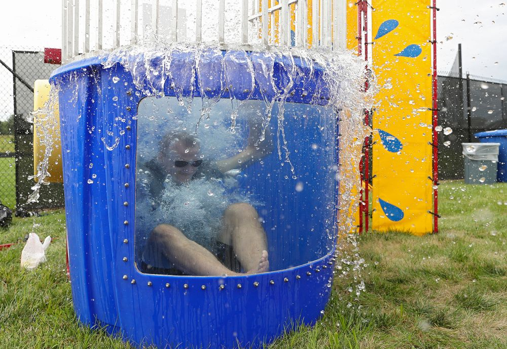 Iowa Swimming head coach Marc Long drops into the water in the dunk tank during the Student-Athlete Kickoff outside the Karro Athletics Hall of Fame Building in Iowa City on Sunday, Aug 25, 2019. (Stephen Mally/hawkeyesports.com)