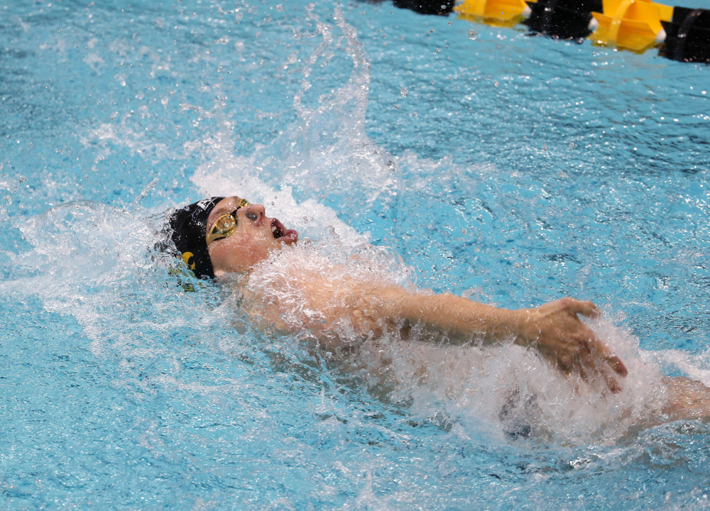 IowaÕs John Colin competes in the 100 yard backstroke against Notre Dame and Illinois Saturday, January 11, 2020 at the Campus Recreation and Wellness Center.  (Brian Ray/hawkeyesports.com)