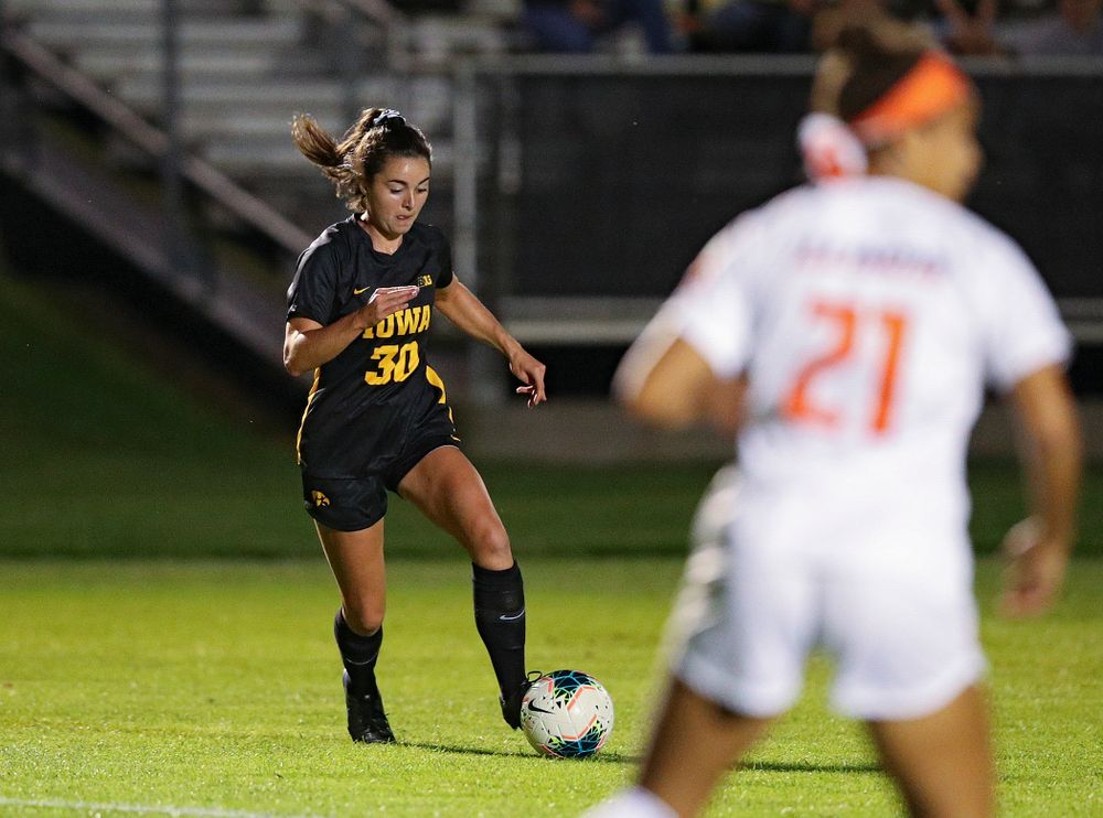 Iowa forward Devin Burns (30) settles the ball before scoring a goal during the first half of their match against Illinois at the Iowa Soccer Complex in Iowa City on Thursday, Sep 26, 2019. (Stephen Mally/hawkeyesports.com)