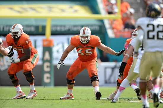 University of Miami Hurricanes offensive lineman Brandon Linder #65 gets set to block in a game against the Wake Forest Demon Deacons at Sun Life...