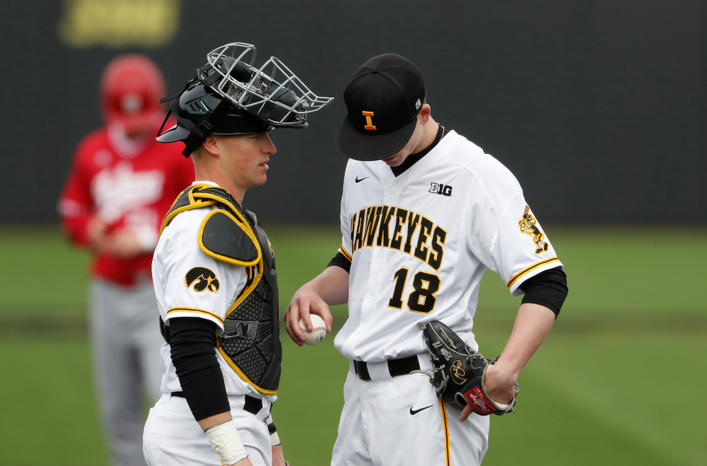Iowa Hawkeyes catcher Tyler Cropley (5) and pitcher Shane Ritter (18) during a double header against the Indiana Hoosiers Friday, March 23, 2018 at Duane Banks Field. (Brian Ray/hawkeyesports.com)