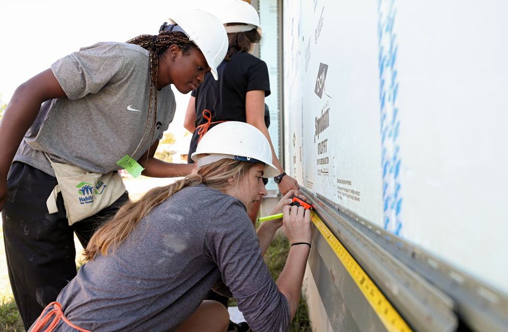 Iowa's Tomi Taiwo (from left) and Kate Martin work on a Habitat for Humanity Women Build project in Iowa City on Wednesday, Sep 25, 2019. (Stephen Mally/hawkeyesports.com)