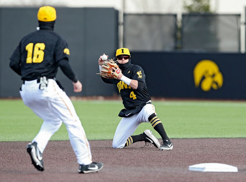 Iowa Hawkeyes second baseman Mitchell Boe (4) prepares to throw the ball to shortstop Tanner Wetrich (16) to start a double play during the sixth inning of their game against Illinois at Duane Banks Field in Iowa City on Saturday, Mar. 30, 2019. (Stephen Mally/hawkeyesports.com)