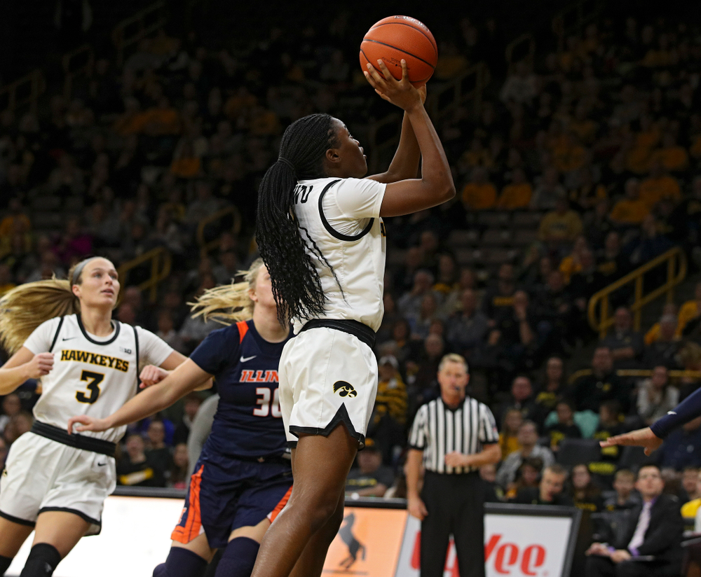 Iowa Hawkeyes guard Tomi Taiwo (1) scores a basket inside during the third quarter of their game at Carver-Hawkeye Arena in Iowa City on Tuesday, December 31, 2019. (Stephen Mally/hawkeyesports.com)