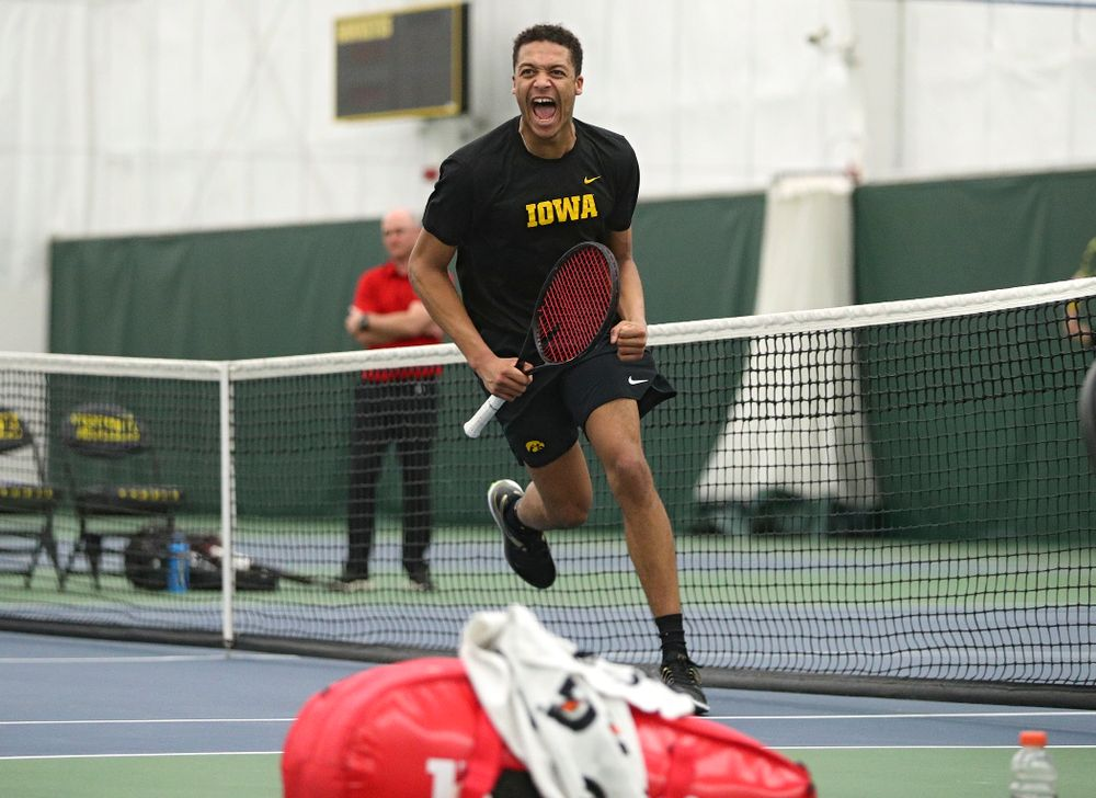 Iowa's Oliver Okonkwo celebrates after winning his singles match at the Hawkeye Tennis and Recreation Complex in Iowa City on Friday, March 6, 2020. (Stephen Mally/hawkeyesports.com)