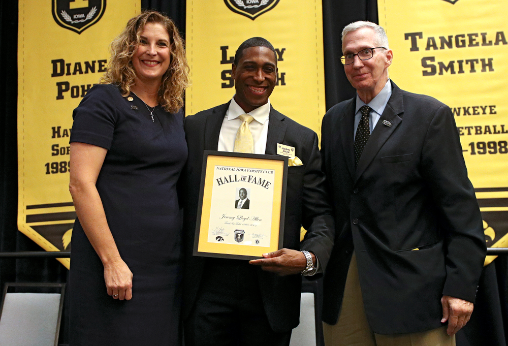 Barb Randall (from left), co-chair of the Varsity Club Advisory Committee, 2019 University of Iowa Athletics Hall of Fame inductee Jeremy Allen, and Andy Piro, assistant athletics director and executive director of the Varsity Club, during the Hall of Fame Induction Ceremony at the Coralville Marriott Hotel and Conference Center in Coralville on Friday, Aug 30, 2019. (Stephen Mally/hawkeyesports.com)
