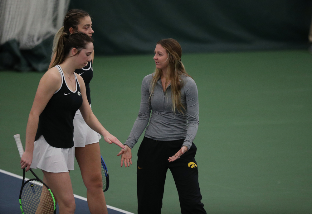 Iowa's Sophie Clark and Sam Mannix during a doubles match against North Texas Sunday, January 20, 2019 at the Hawkeye Tennis and Recreation Center. (Brian Ray/hawkeyesports.com)