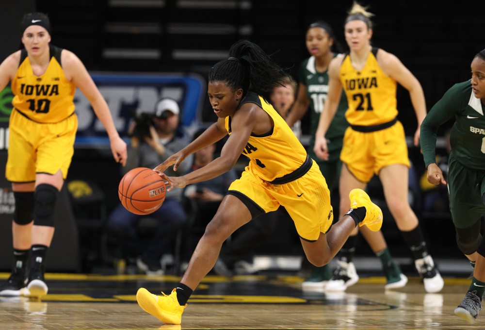 Iowa Hawkeyes guard Tomi Taiwo (1) steals the ball against the Michigan State Spartans Thursday, February 7, 2019 at Carver-Hawkeye Arena. (Brian Ray/hawkeyesports.com)